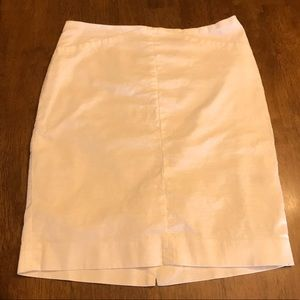 White pencil skirt in size 8. Cute detailing!